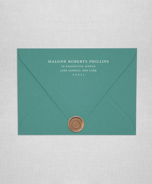 Emerald Green wedding invitation envelopes with white ink addressing and wax seals