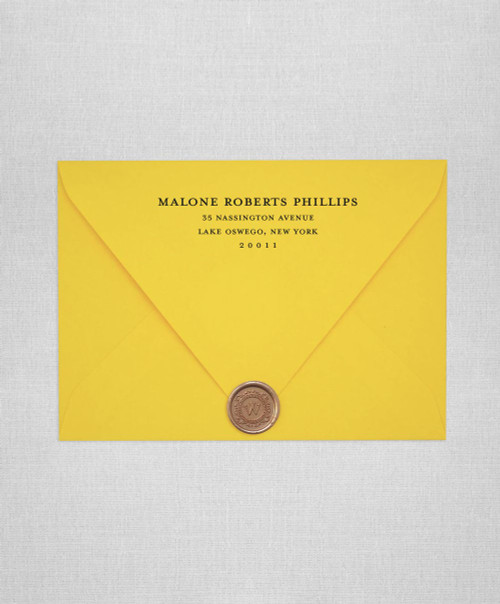 Yellow wedding invitation envelopes with white ink addressing and wax seals