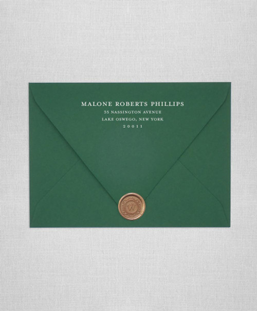 Forest Green wedding invitation envelopes with white ink addressing and wax seals