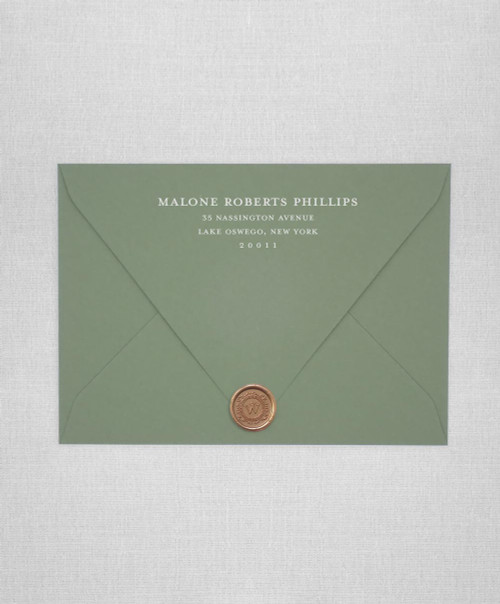 Sage wedding envelopes with white ink return addressing and gold wax seals