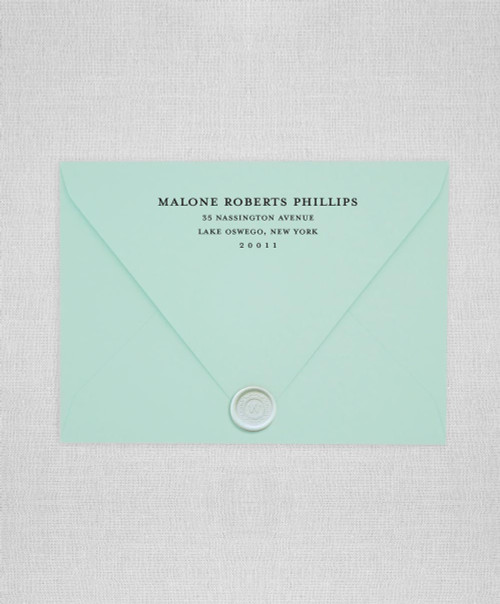 Mint Green wedding envelopes with white ink return addressing and gold wax seals