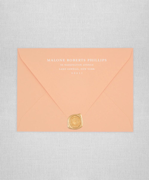 Peach wedding envelopes with white ink return addressing and gold wax seals