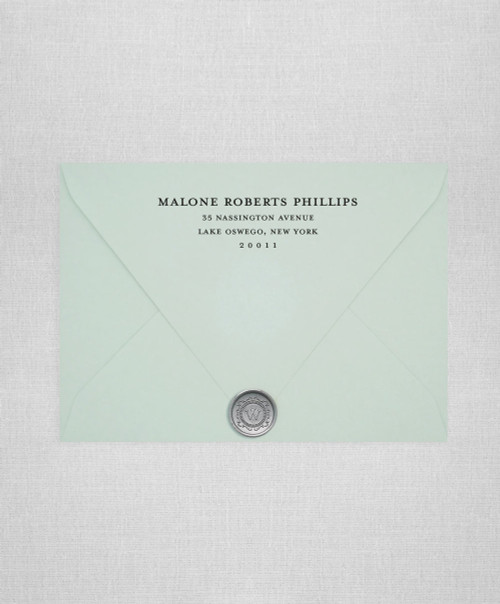 Powder Green wedding envelopes with white ink return addressing and gold wax seals