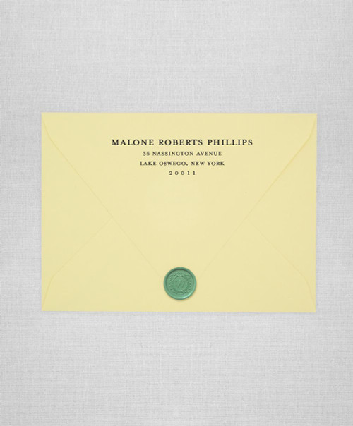 Light Yellow wedding envelopes with white ink return addressing and green wax seals