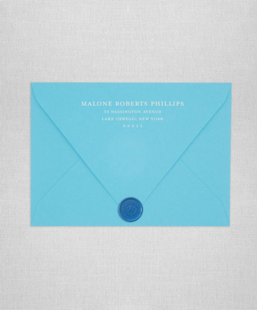 Turquoise wedding envelopes with white ink return addressing and gold wax seals