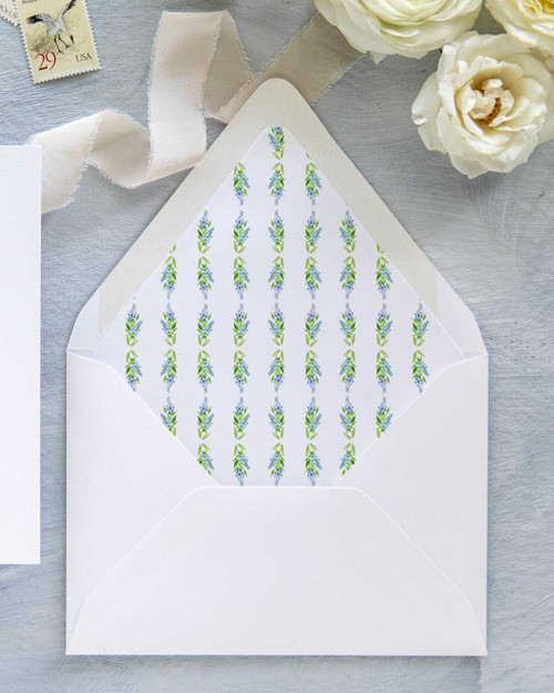 hand-painted watercolor pattern using blue delphinium flowers sprinkled with lush evergreen leaves envelope liner
