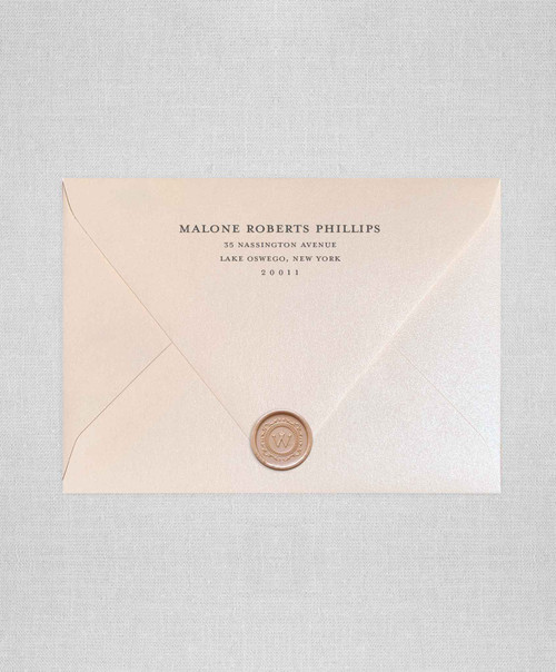 Soft Coral wedding envelopes with white ink return addressing and gold wax seals