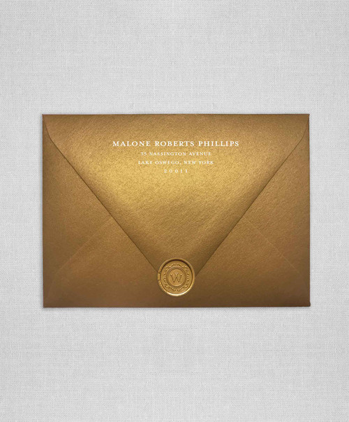 Antique Gold Metallic wedding envelopes with white ink return addressing and gold wax seal