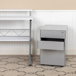 gray desk pedestal in workspace