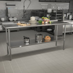 stainless table with backsplash in kitchen