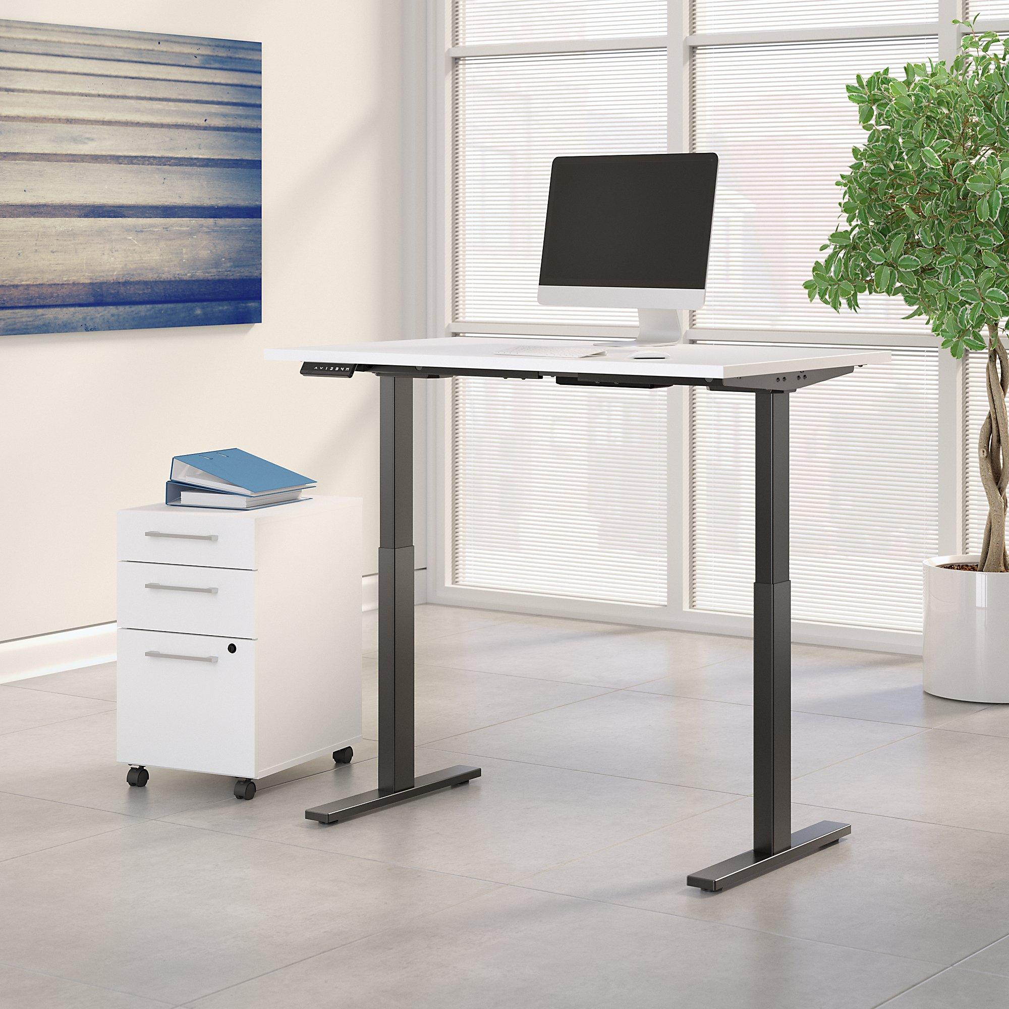 white adjustable desk with file