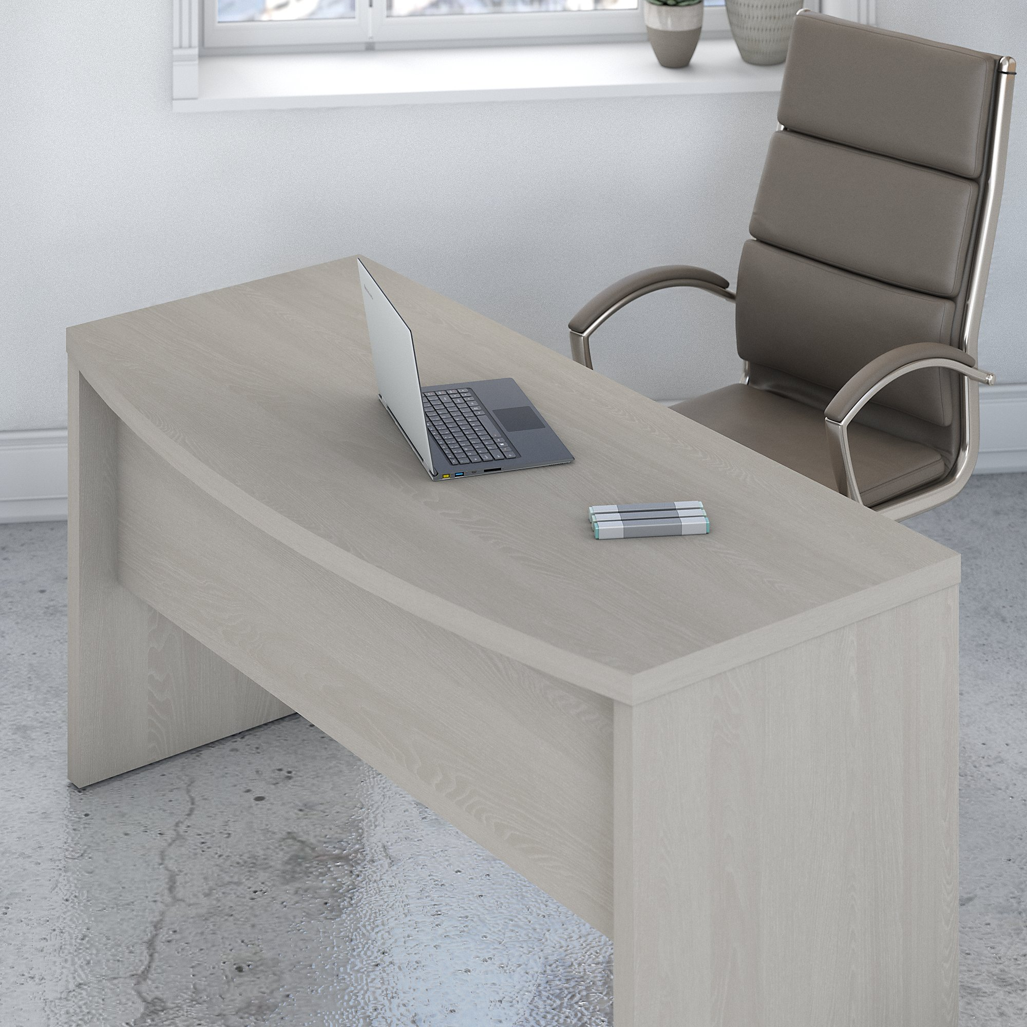 gray sand bow front l desk overhead view