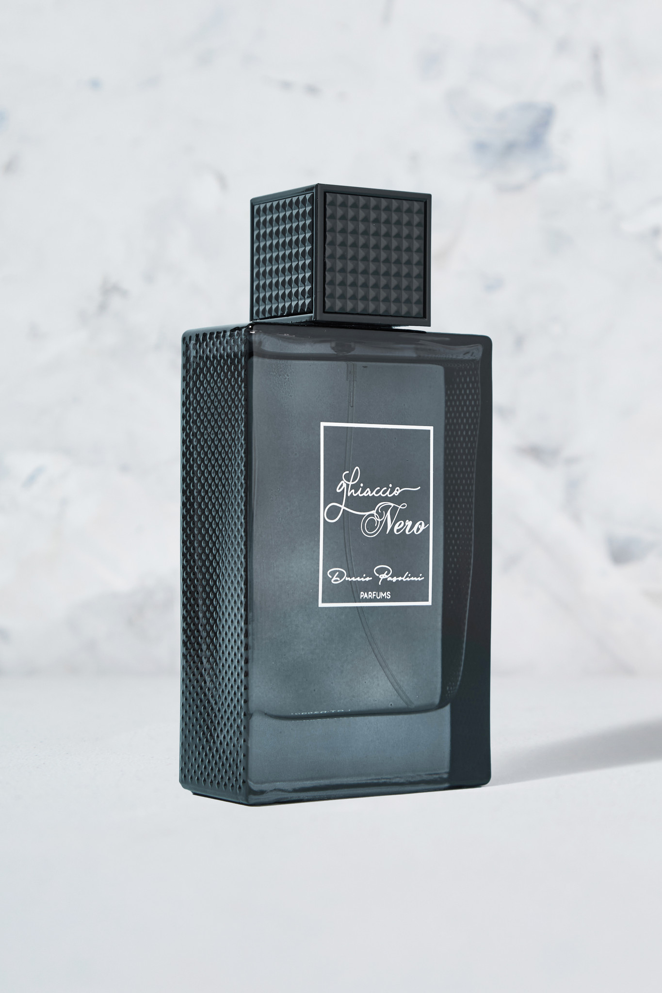 Ghiaccio Nero Perfume (Black Ice) is an intense and elegant aromatic Parfum Extract born from the blend of aromatics, fresh lemon, and moss. The fragrance is designed for the man who appreciates European fashion and elegance. Fresh lavender and delicious lemon are paired with the sweet pineapple and a final touch of moss, creating an intense and daring aromatic and citrus fragrance. Top Notes: Lavender and Lemon. Middle Notes: Pineapple. Base Notes: Moss. Key Notes: Aromatic, Citrus, Sweet, Woody & Fresh Spicy.