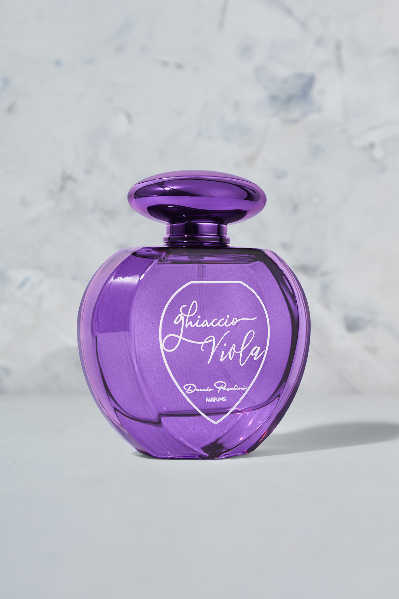 Ghiaccio Viola (Purple Ice) leads with a polished blend of citrus, fruit and floral notations for the vibrant and compassionate woman. Designed for women who enjoy the sensual and passionate aspects of life. This symphony begins with luscious green apple, citrus and juicy white peach, followed by watermelon with delicate rose water, and ending with notes of sandalwood and musk.  Top Notes: Green Apple, Lemon, Tangerine, and White Peach. Middle Notes: Rose Water & Watermelon. Base Notes: Sandalwood and White Musk. Key Notes: Citrus, Fruity, Rose, Aquatic, Woody, & Ozonic.
