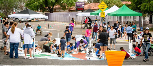 200+ Neighbors and Families in South Tucson Transform School Crossing with Tactical-Urbanism Traffic Circle