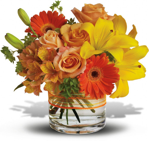 Know someone who could use a little pick-me-up? Sending this pretty summer arrangement will definitely do the trick.