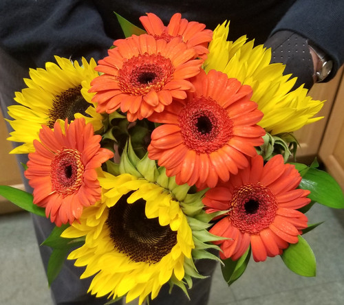 Maid of Honor Bqt in a bold mix of sun flowers and gerber daisy's !