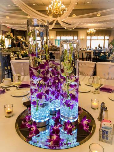 Orchid Cylinder Centerpieces In Purple  (Rentals)