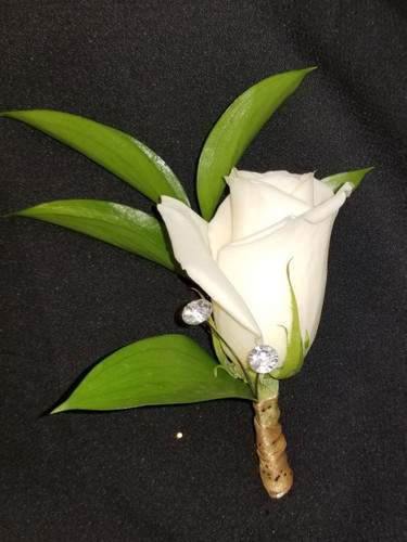 White rose with ribbon wrapped stem and 2 large rhinestones added