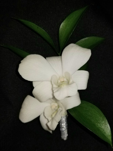 White dendrobium orchid with a silver ribbon wrapped stem