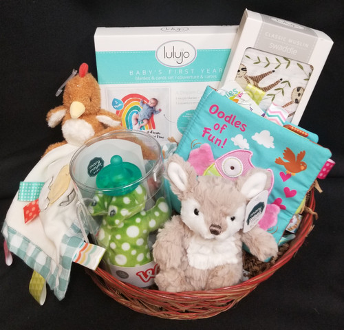 Perfect Welcome Home baby gift, baby shower gift or a Just because!  We can make these up to be more girly or for a baby boy or in gender neutral colors.  This basket includes Mary Meyers taggies blanket, Mary Meyer Wubba nub, small plush , soft book, Swaddle blanket,and baby's 1st year mat!