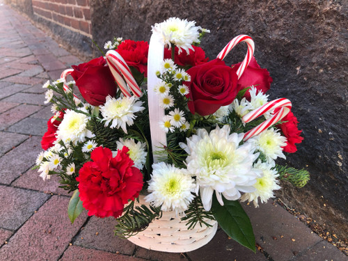 A-tisket, a-tasket, a candy cane Christmas basket. What fun it will be when this cheery basketful of holiday joy gets delivered!