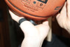 Wear on your shooting hand to help keep the ball of your palm.