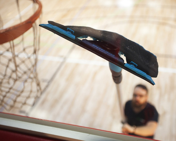 squeegee to wipe away water and leave backboard without streaks