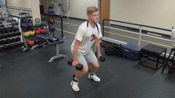 Squats with resistance bands and weights