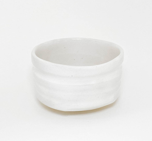 A wide mouthed chawan. Rather heavy, this bowl is for one who is looking for a substantial feel in their hands while enjoying their cup of Matcha. White glaze with a crackled finish. Perfect to use for your morning oatmeal or donburi (Japanese rice dish) lunch or dinner as well.