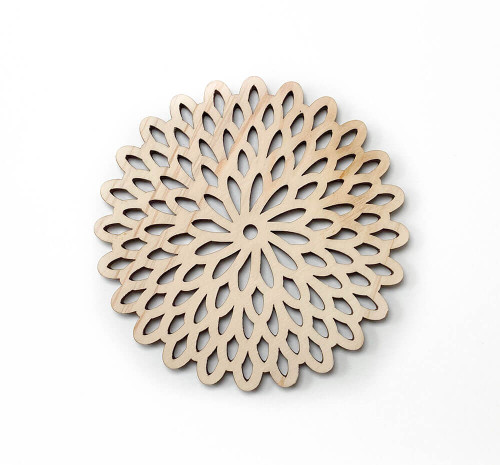 This coaster has a kiku or chrysanthemum shape, a prevalent Japanese motif used for the imperial family crest as well as patterns on textiles and teaware to symbolize longevity and the seasons.