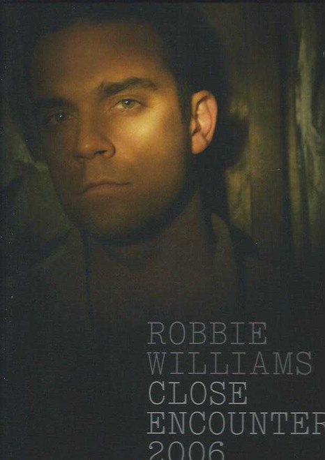 """Robbie Williams 2006 Close Encounters Tour, Robert Peter """"Robbie"""" Williams (born 13 February 1974) is an English singer-songwriter, and occasional actor. He is a member of the pop group Take That, but has found greater commercial success as a solo artist."""