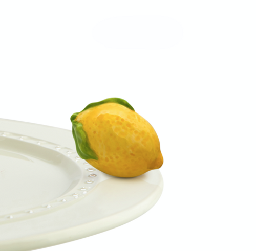 when life hands you lemons, you make lemon minis! this lemon squeeze mini will be a fresh edition to your nora fleming collection