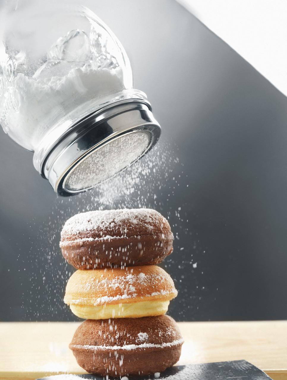 Sprinkle powdered sugar from the jar.