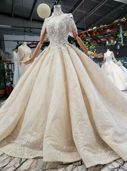 Luxurious Champagne Ball Gown Tulle Sequins V-neck Backless Beading Wedding Dress
