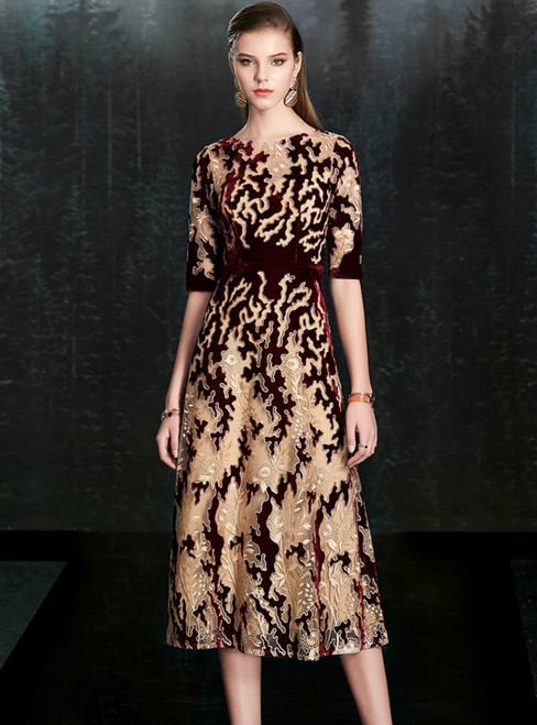 Is a Rite Of Passage Champagne And Burgundy Velvet Short Sleeve Mother of the Bride Dress