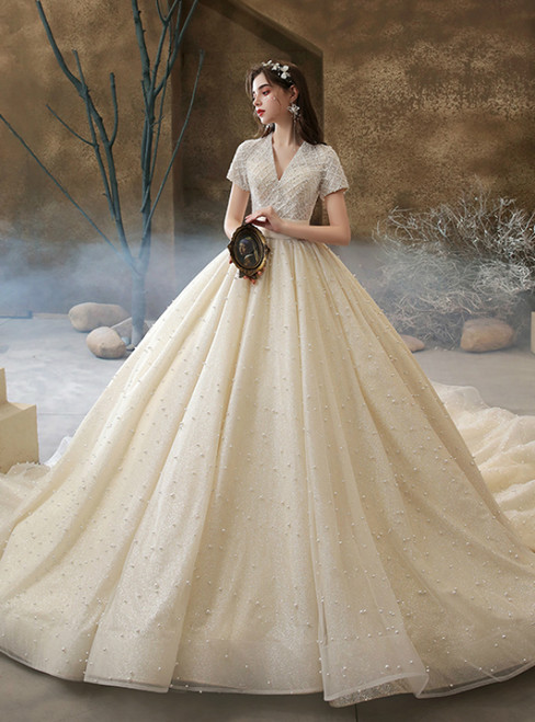 We Provide Champagne Tulle V-neck Short Sleeve Beading Pearls Wedding Dress