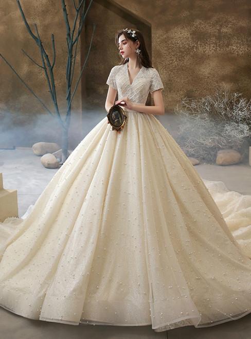 We Provide Champagne Tulle V-neck Short Sleeve Beading Pearls Wedding Dress