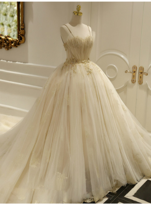 Champagne Ball Gown Tulle Spaghetti Straps Backless Wedding Dress