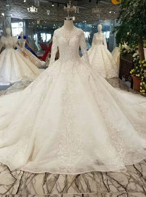 Ball Gown Tulle Lace Appliques Long Sleeve Backless Wedding Dress With Beading