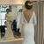 White Mermaid Satin Lace Long Sleeve Backless Wedding Dress