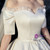 Ivory White Ball Gown Satin Off the Shoulder Short Sleeve Wedding Dress With Bow