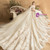 Champagne Ball Gown Tulle Appliques Long Sleeve Backless Wedding Dress With Train