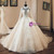 Champagne Tulle Lace Long Sleeve High Neck Backless Wedding Dress With Pearls