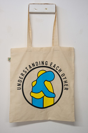 Mental health awareness beige tote bag, earth positive