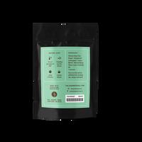 2 oz. packaging for Honey Lemon Ginger loose leaf green tea from The Jasmine Pearl Tea Co.