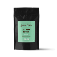 2 oz. packaging for Jasmine Peony loose leaf green tea from The Jasmine Pearl Tea Co.