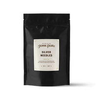 2 oz. packaging for Silver Needles loose leaf white tea from The Jasmine Pearl Tea Co.