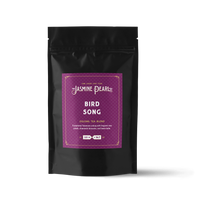 2 oz. packaging for Bird Song Oolong loose leaf tea from The Jasmine Pearl Tea Co.