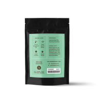 2 oz. packaging for Yuzu Green loose leaf green tea from the Jasmine Pearl Tea Co.